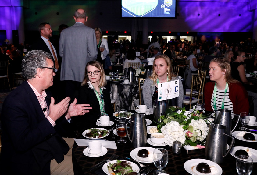 Jeff Provost shares his thoughts with finalists CeCealia Schultz, Lexie Tabbert, and winner Kylee Beaver before the award presentation.